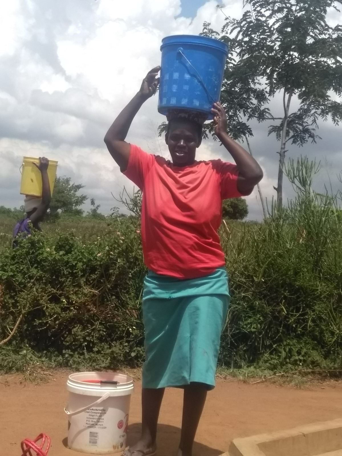 Monica walks to Tanzania (30 miles) four times a day carrying 20 liters (5 gallons) of water each time on her head