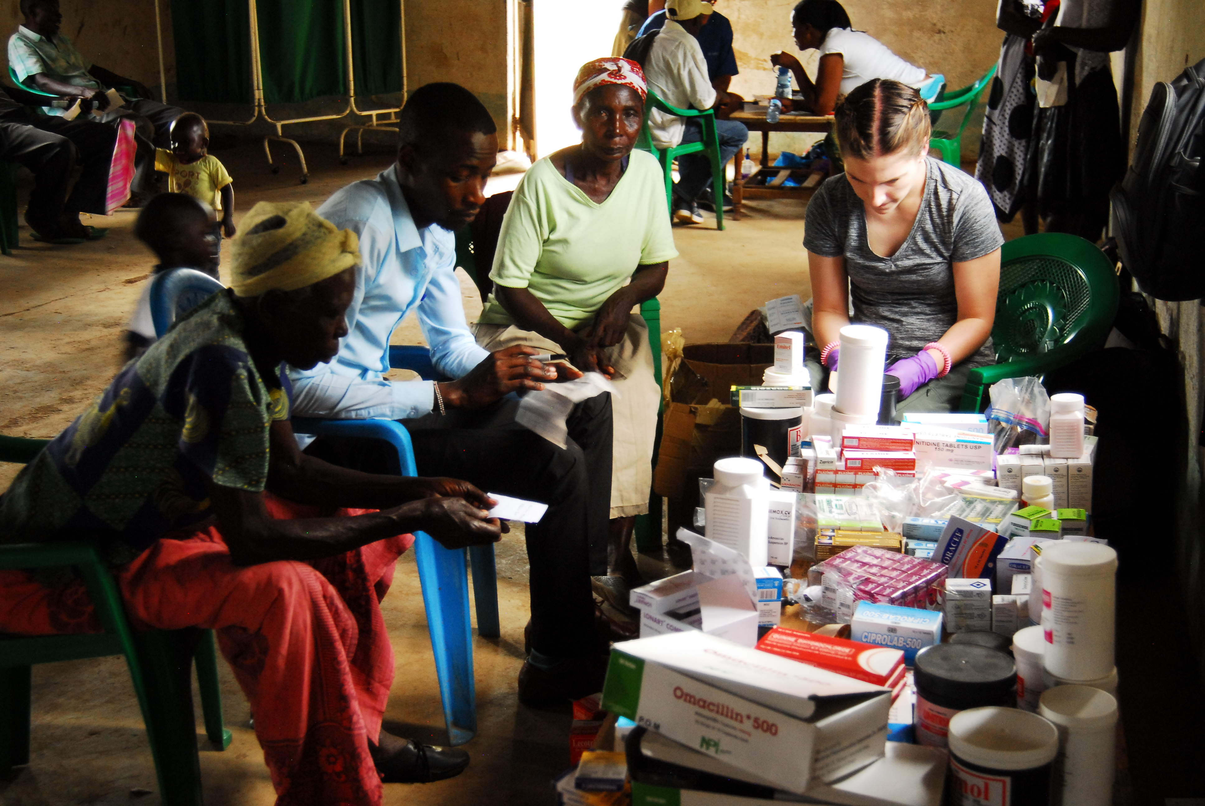 Courtney dispensing medicine at the mobile clinic